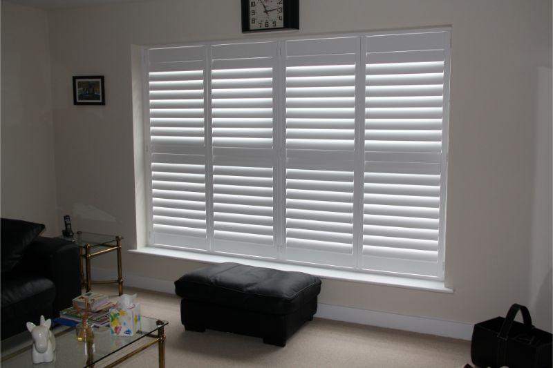 white-window-shutters-downstairs